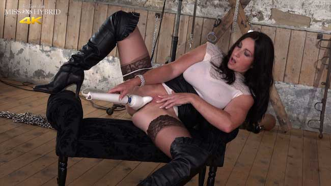 Miss Hybrid leather boots mistress playing with her magic wand.