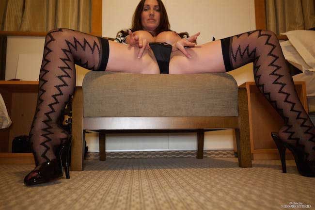 Stockings suspenders high heels and big tits, Miss Hybrid strips in her cabin.